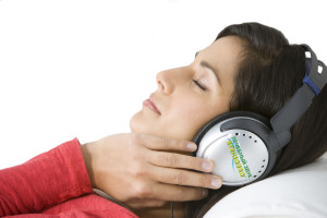 Woman Relaxing Listening To Music Wearing Headphones